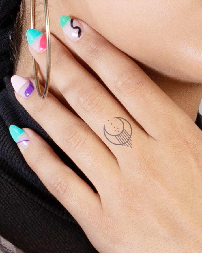 Finger tattoo ideas for females: Tribal crescent moon