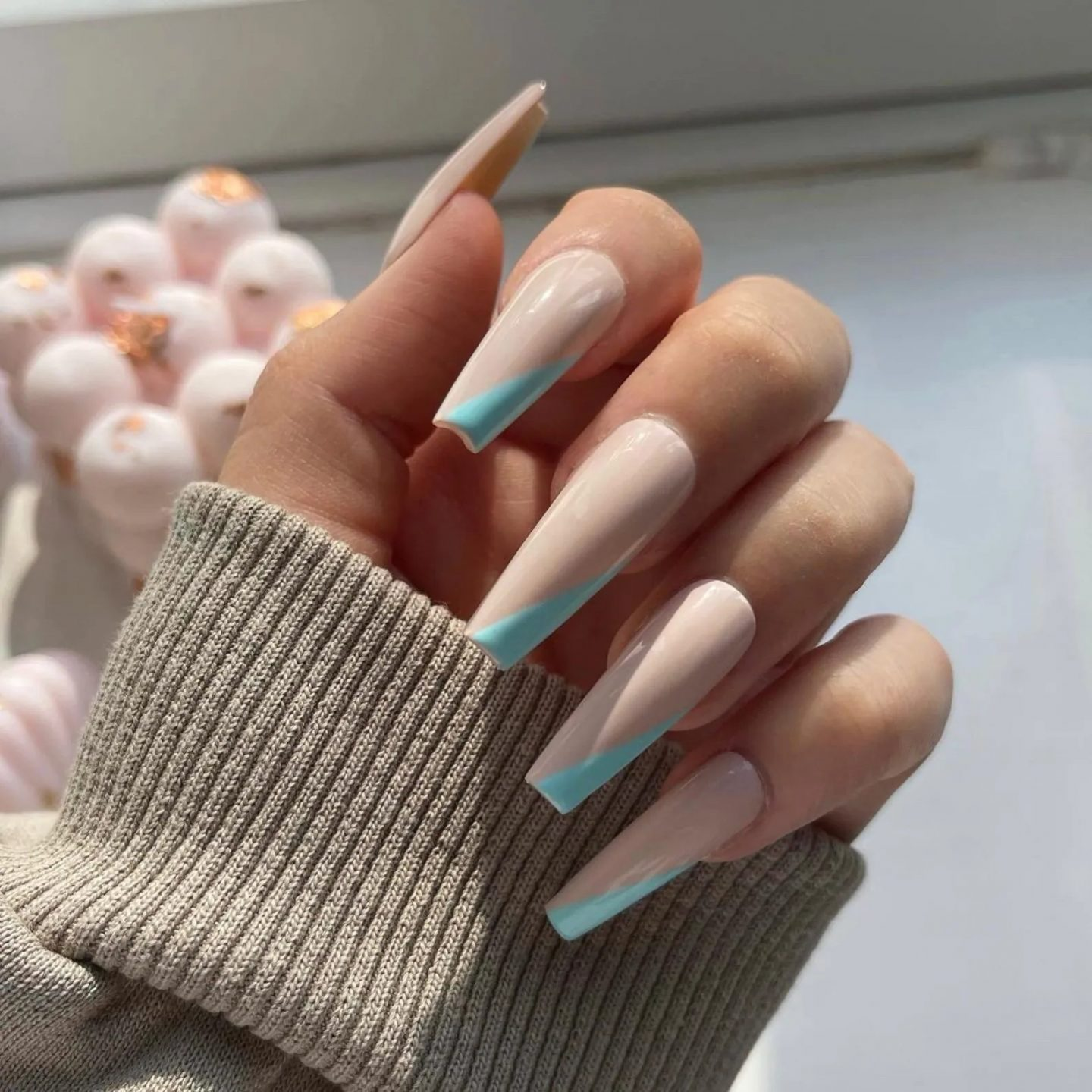 Mint green French tip nails in coffin shape