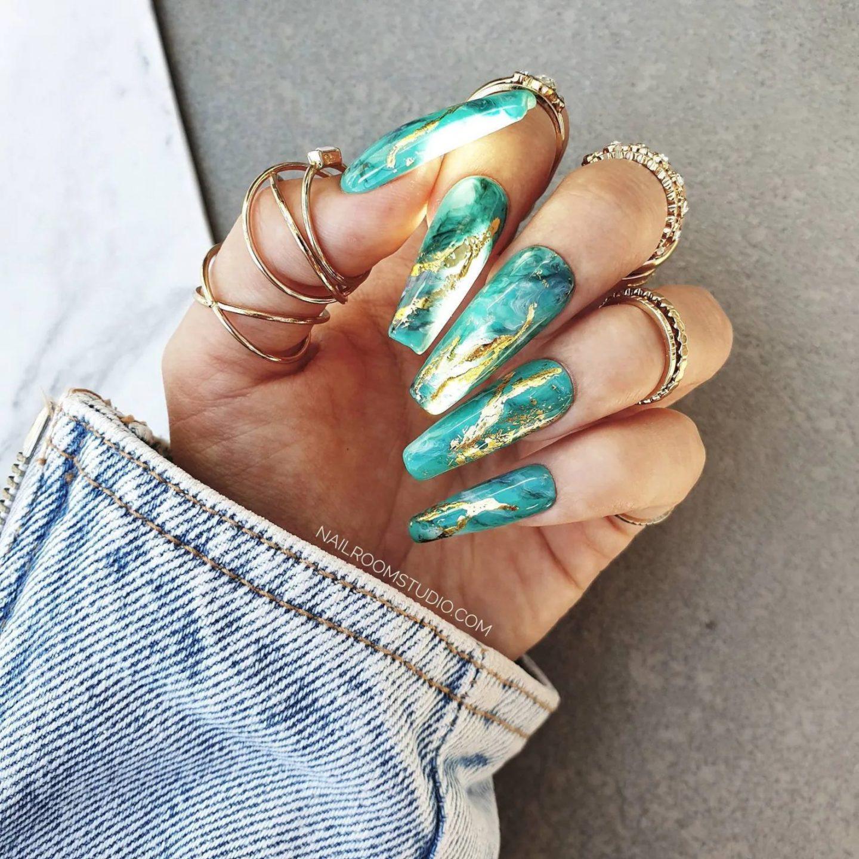 Beautiful sea foam green nails with gold foil