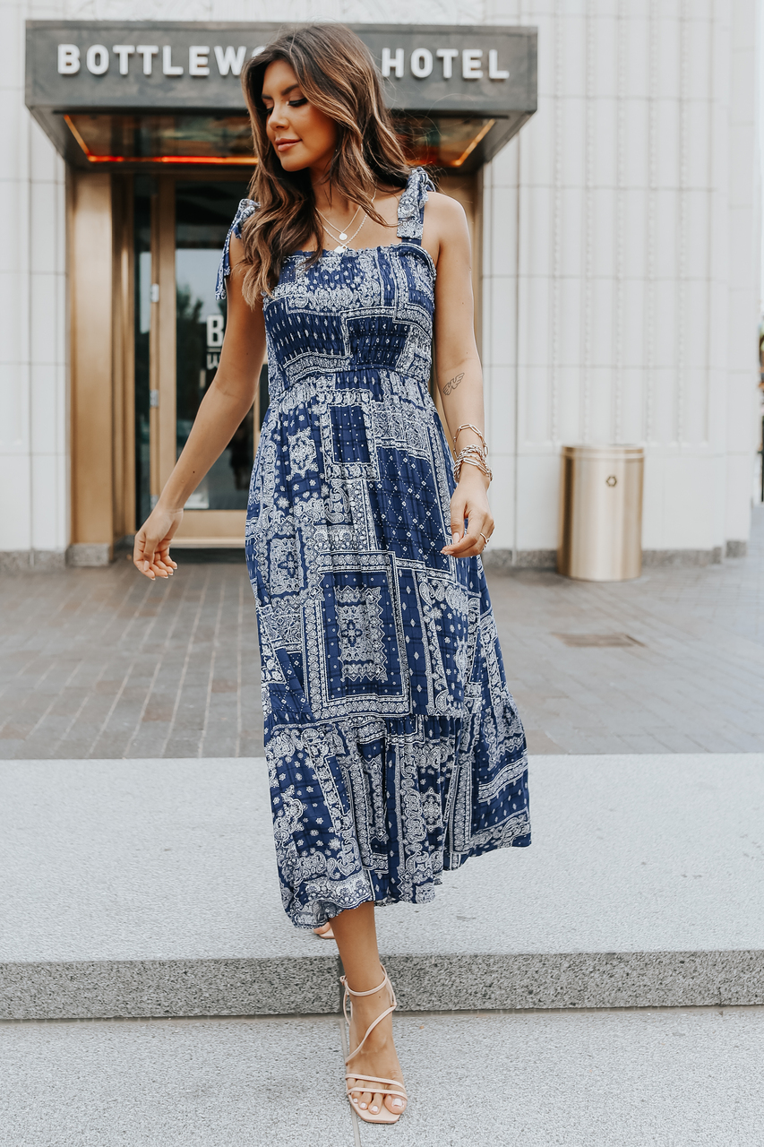 Navy blue maxi dress with strappy sandals