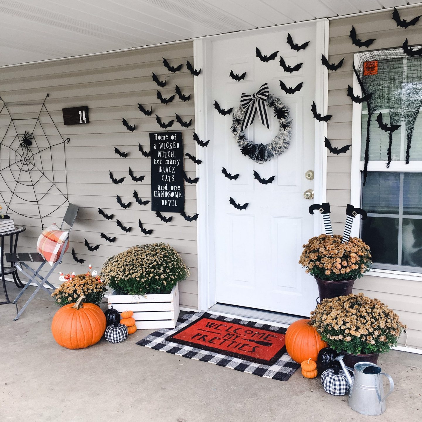 Outdoor Halloween decor for front porch with bats
