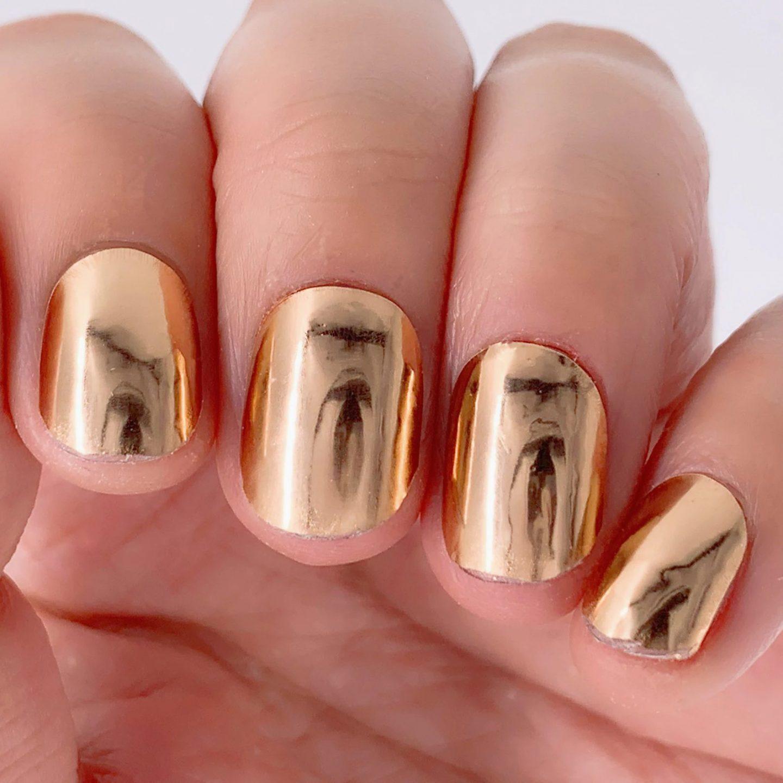 Short metallic rose gold nails with shine