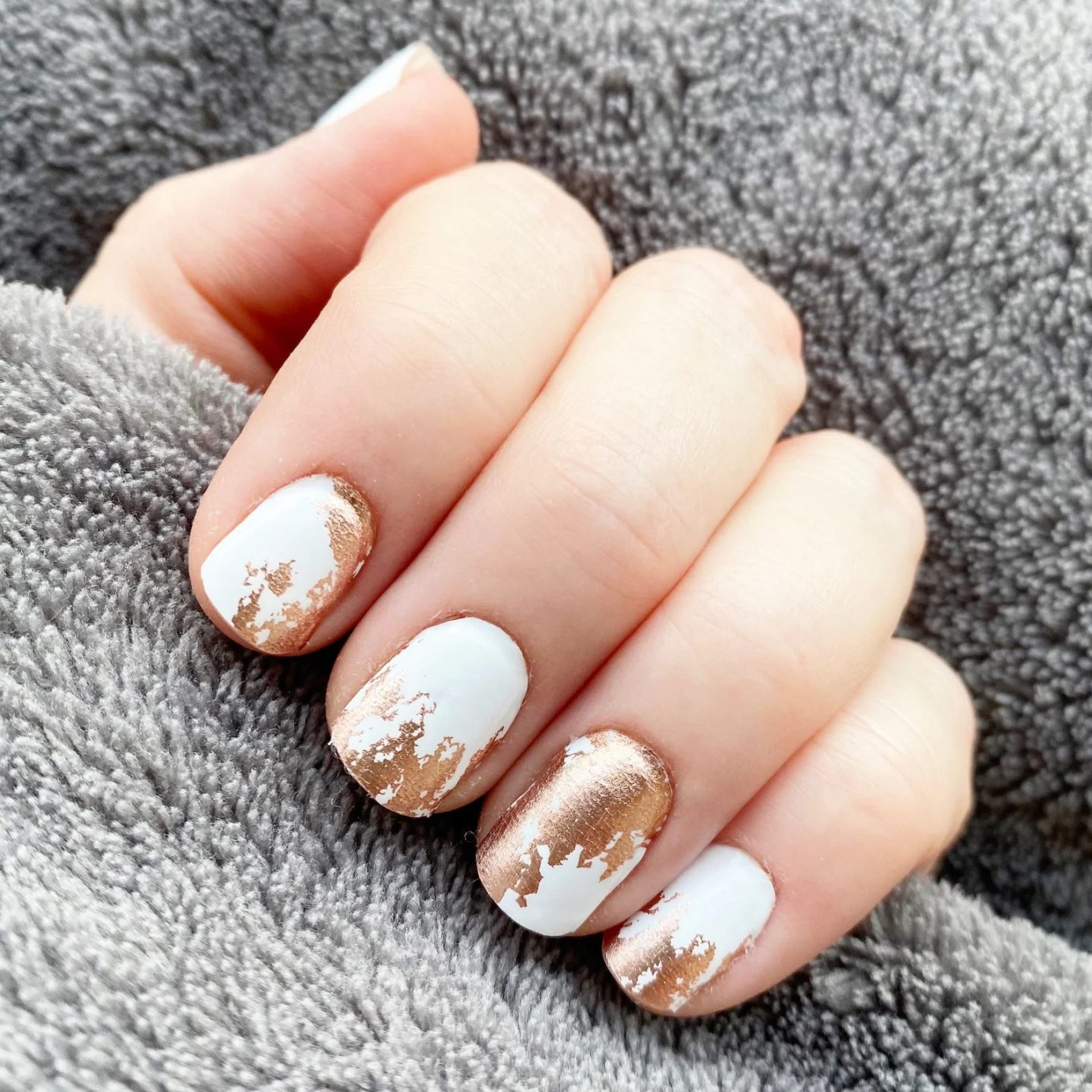Short white and rose gold nails