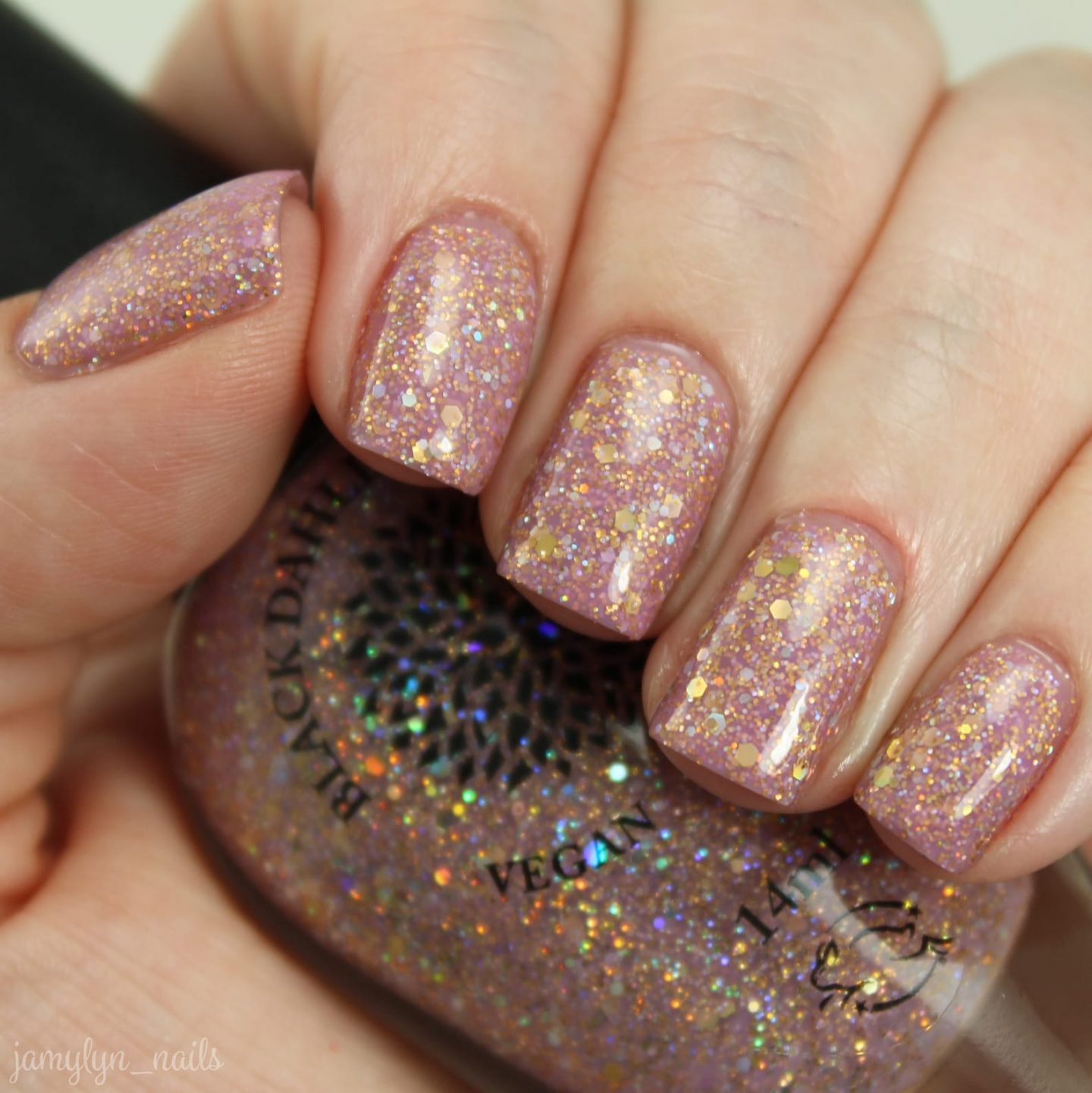 Cute short rose gold nail polish with glitter