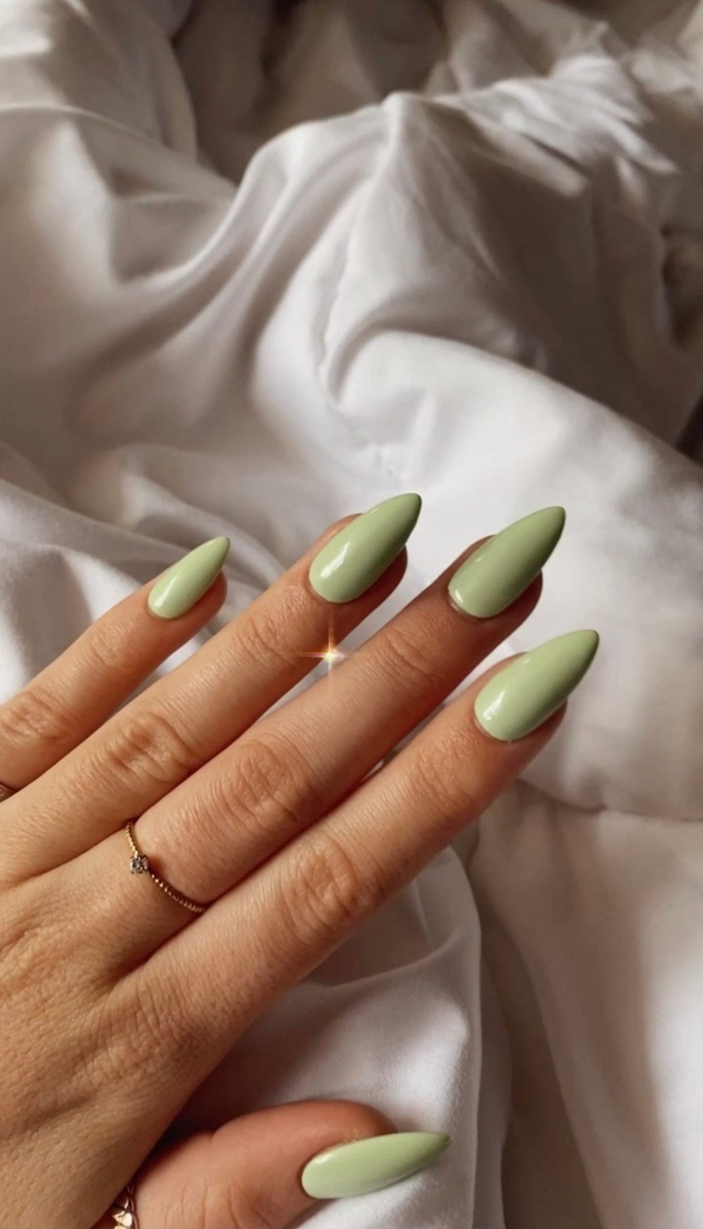 Pastel sage green almond nails