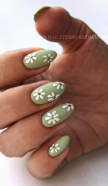 Cute sage green almond nails with daisy nail art