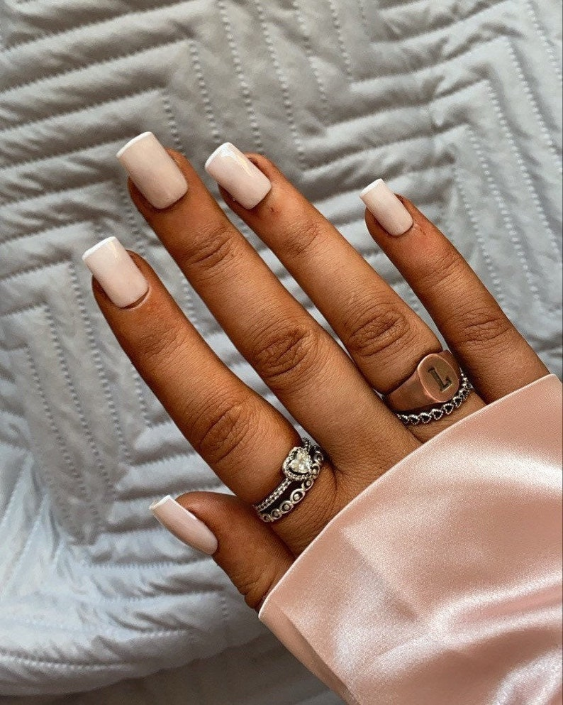Short nude square nails with white French tips