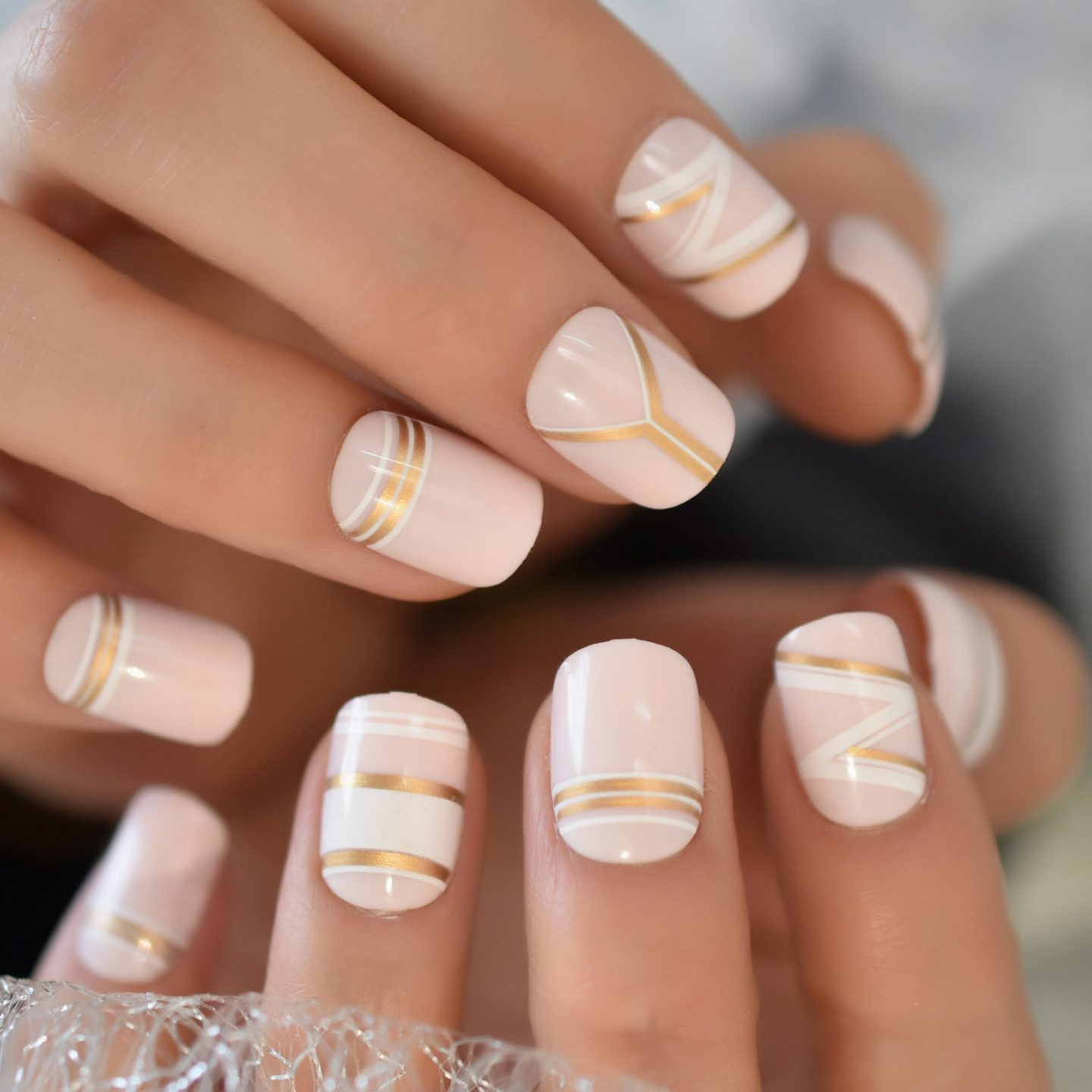 Cute short pink nails with gold and white nail art