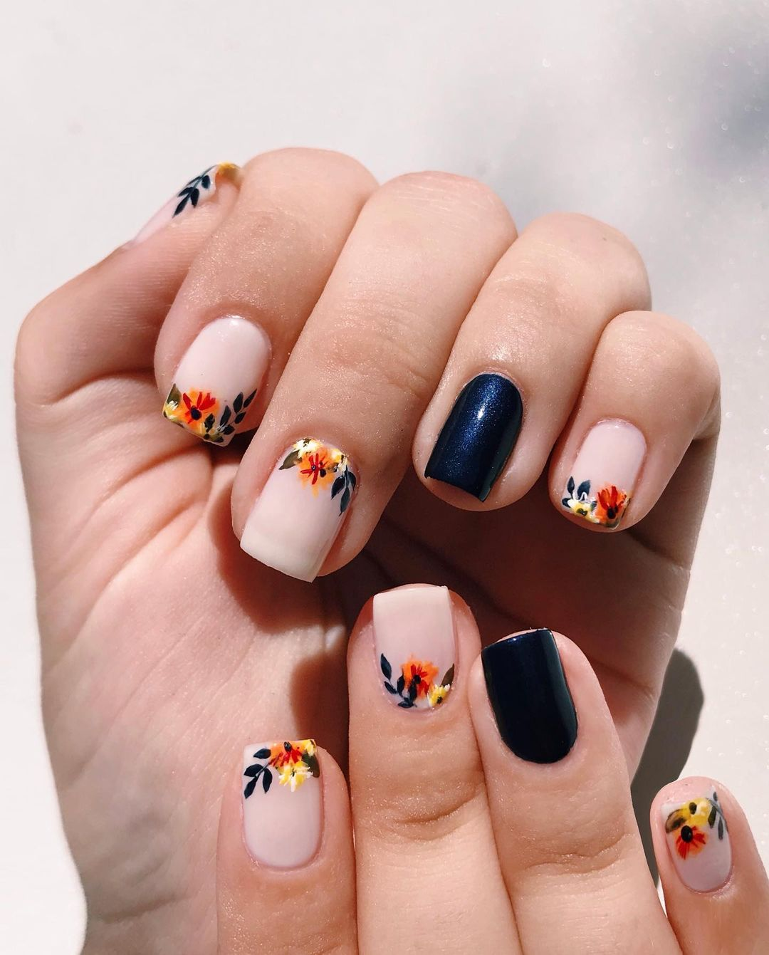 Cute short square nails with dark blue and flower nail art