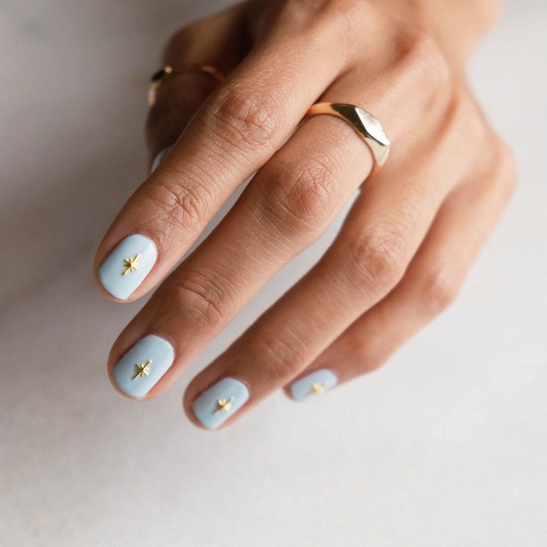 Cute short baby blue square nails with stars