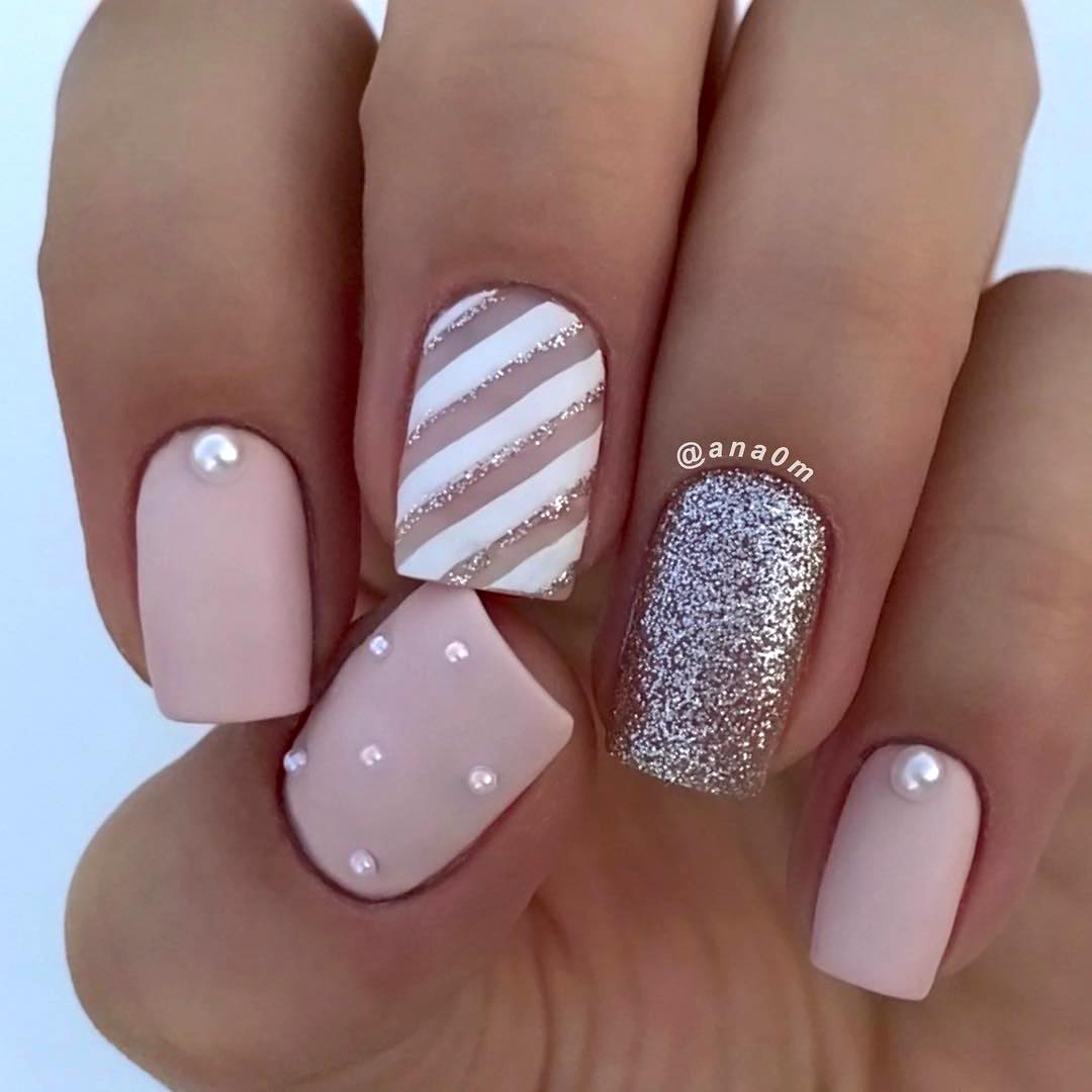 Cute short pink and white candy cane square nails with glitter