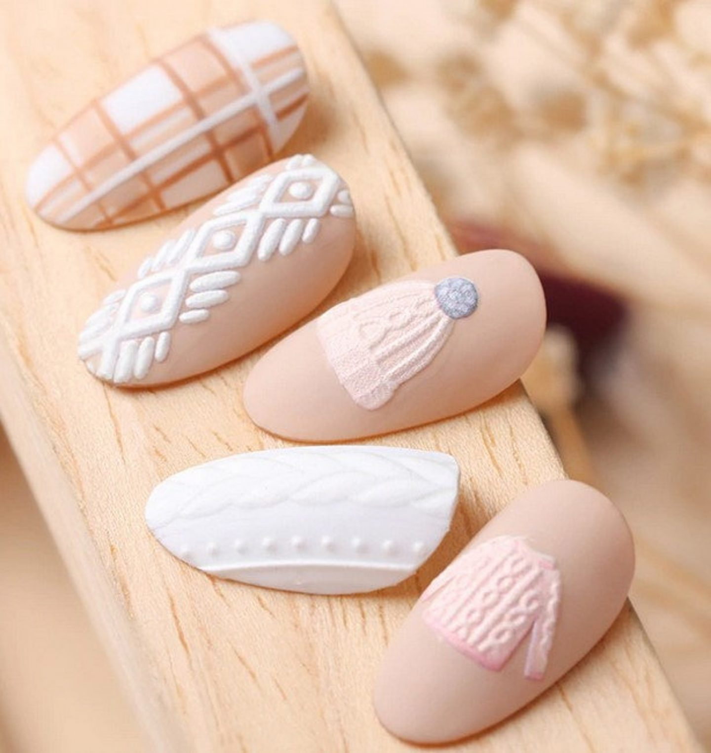 Cute light pink and white sweater nails