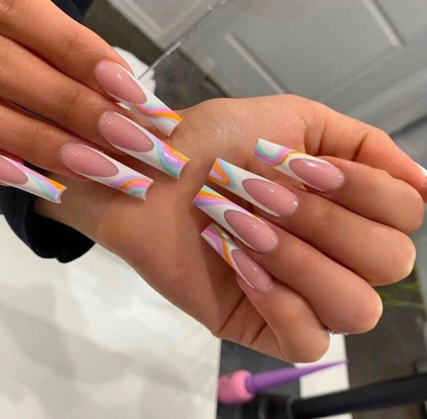 Cute long French tip nails with swirls in coffin shape