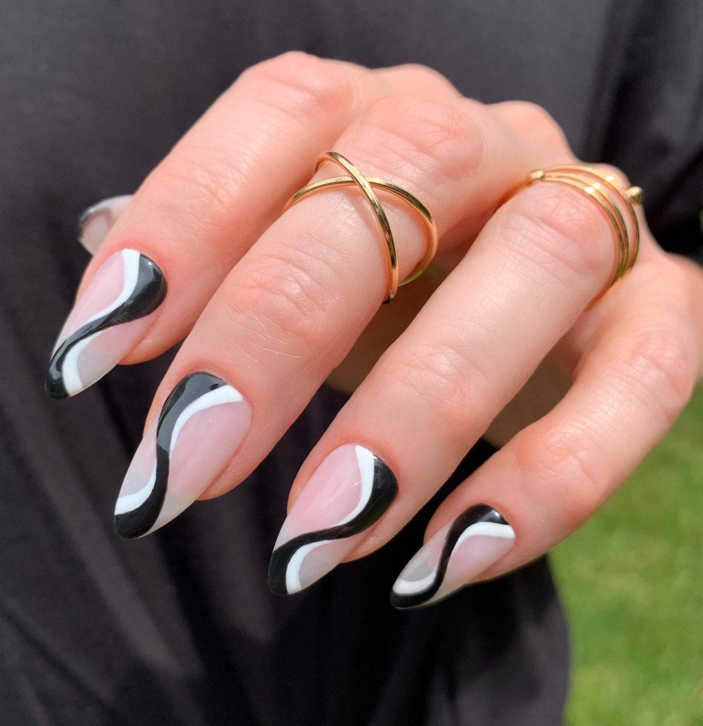 Cute black and white swirl nails in almond shape