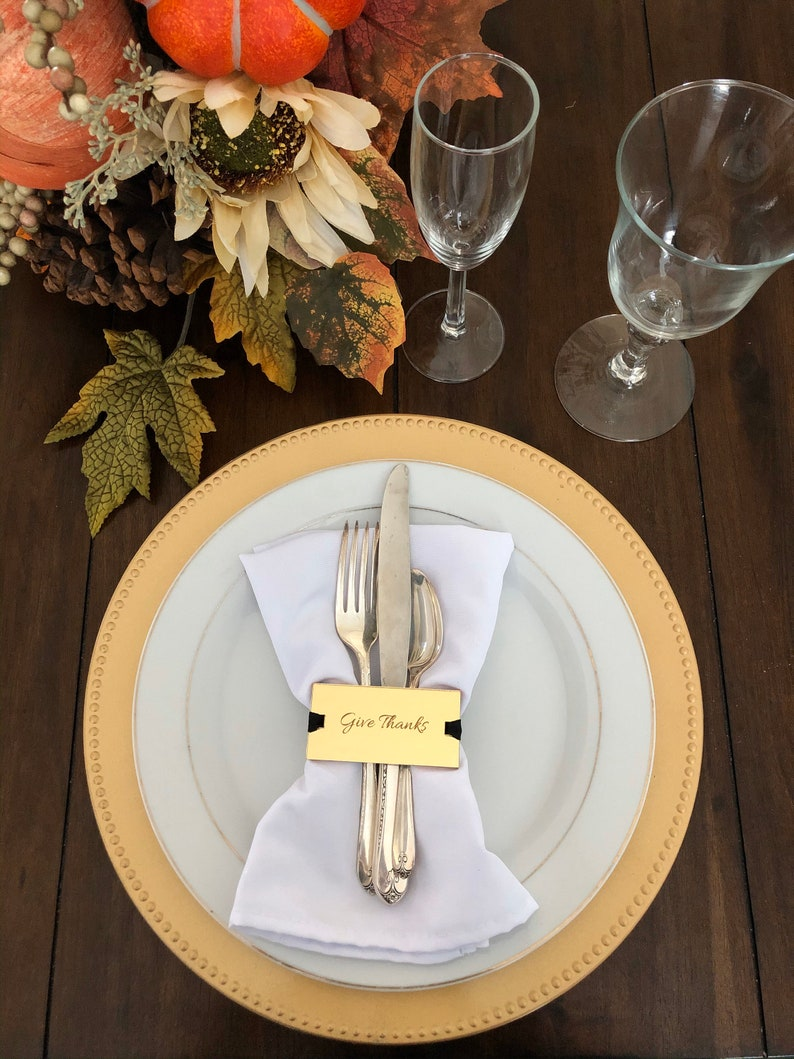Thanksgiving table settings with gold napkin rings