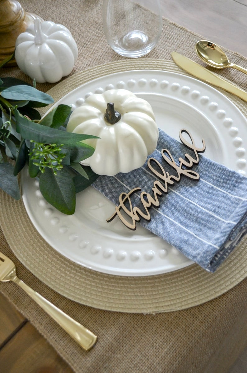 White & Gold Thanksgiving table settings with pumpkins