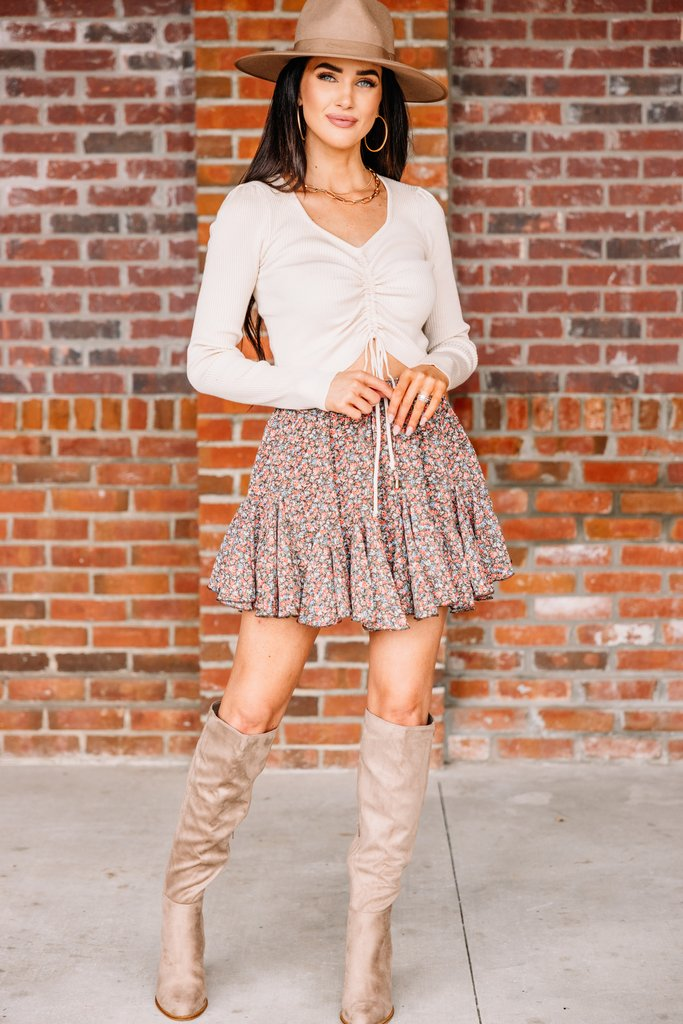 What to wear with thigh high boots: floral skirts with ruffles