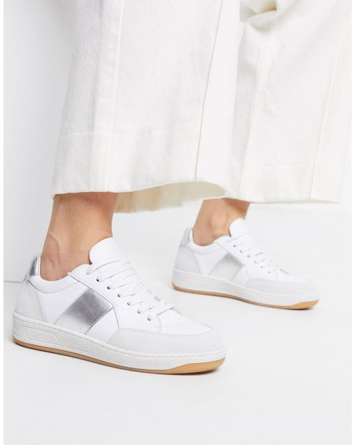 What Color Shoes To Wear With A Navy Dress: Silver and white sneakers
