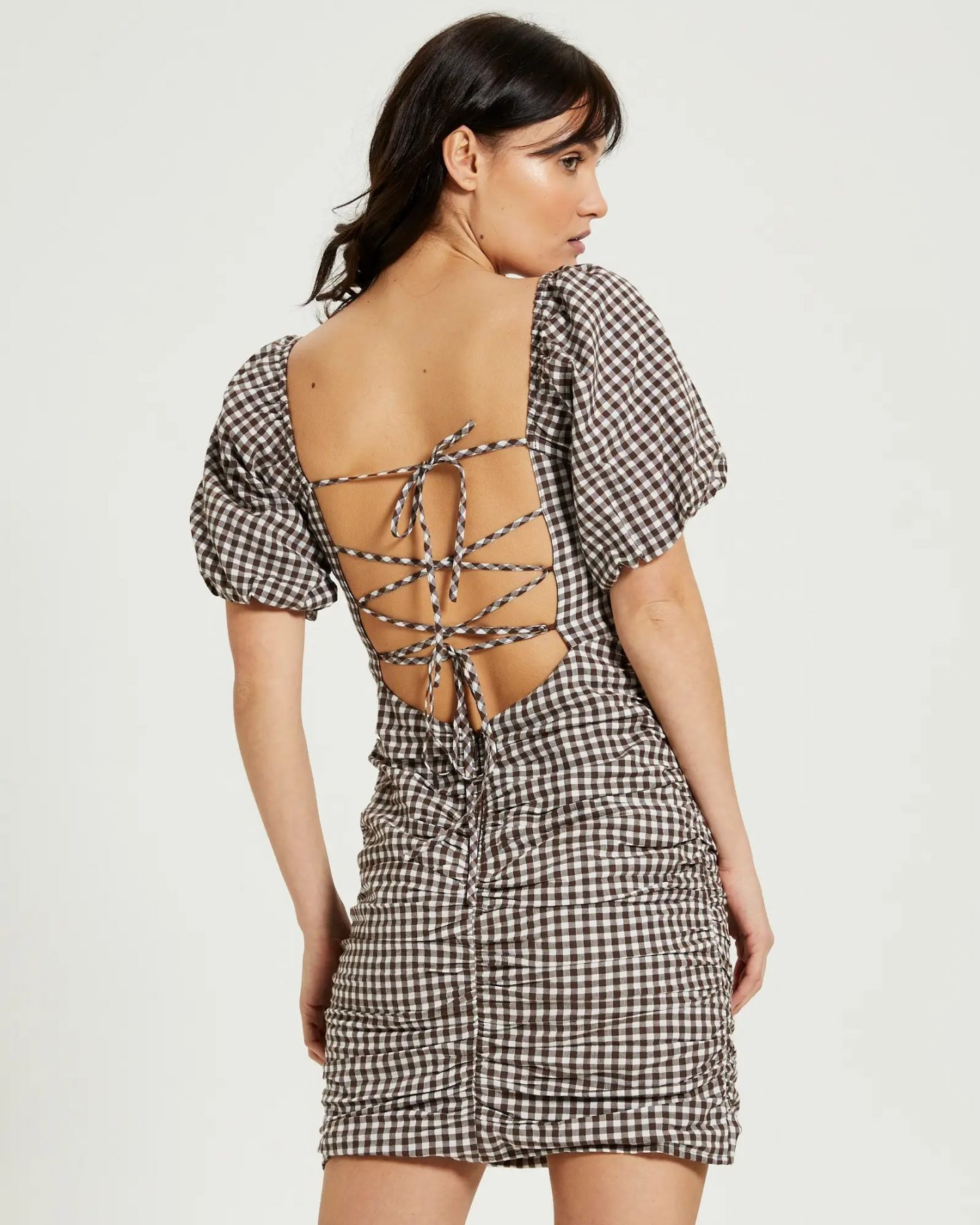 Gingham puff sleeve dress with criss cross back