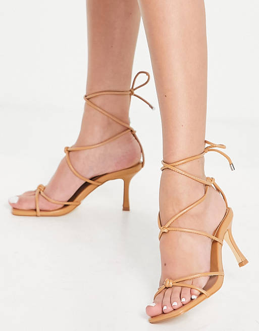 Best Shoe Colors To Wear With A Red Dress: Nude strappy heels