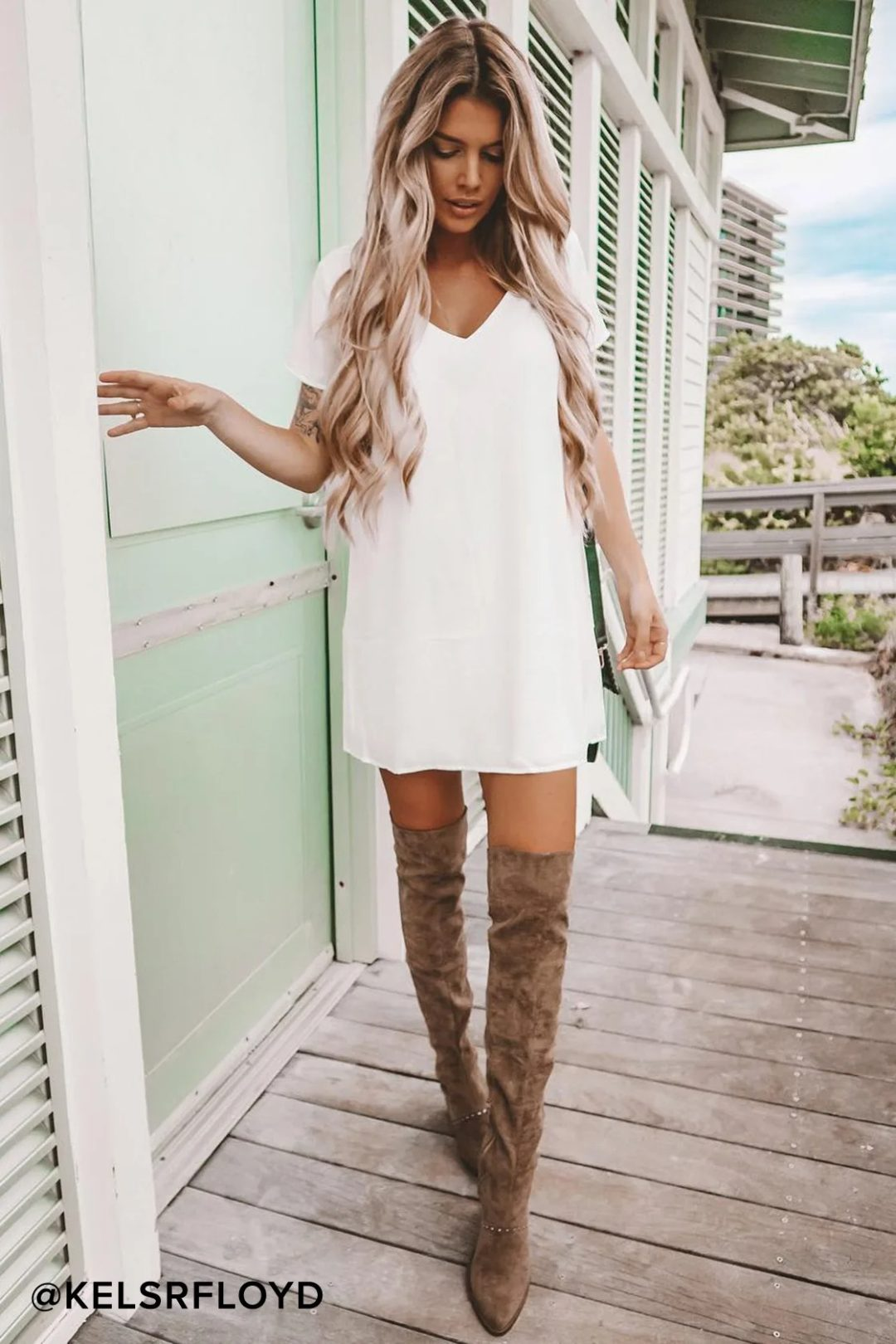 White t-shirt dress with knee-high boots