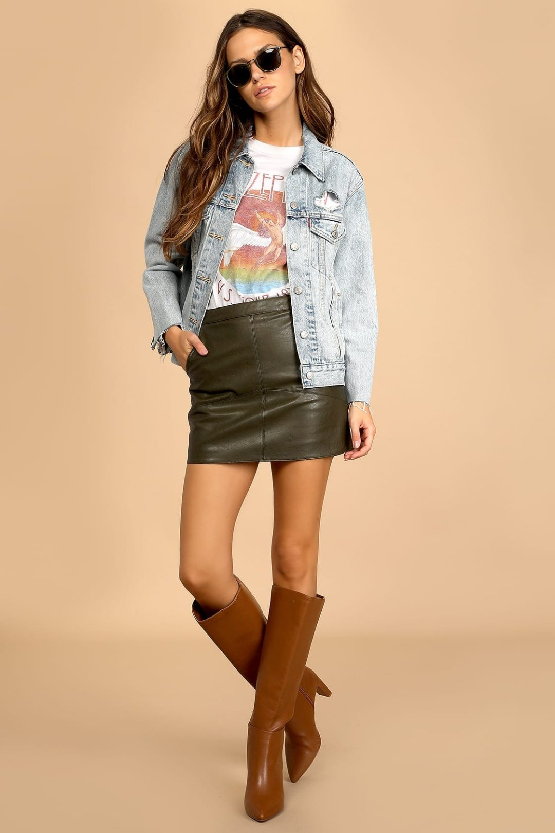 Graphic tee with leather skirt and denim jacket