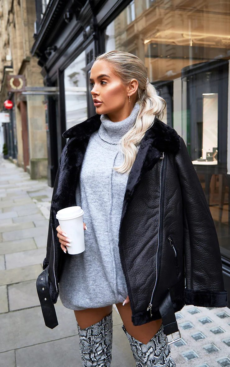 Cute winter baddie look with sweater dress and boots
