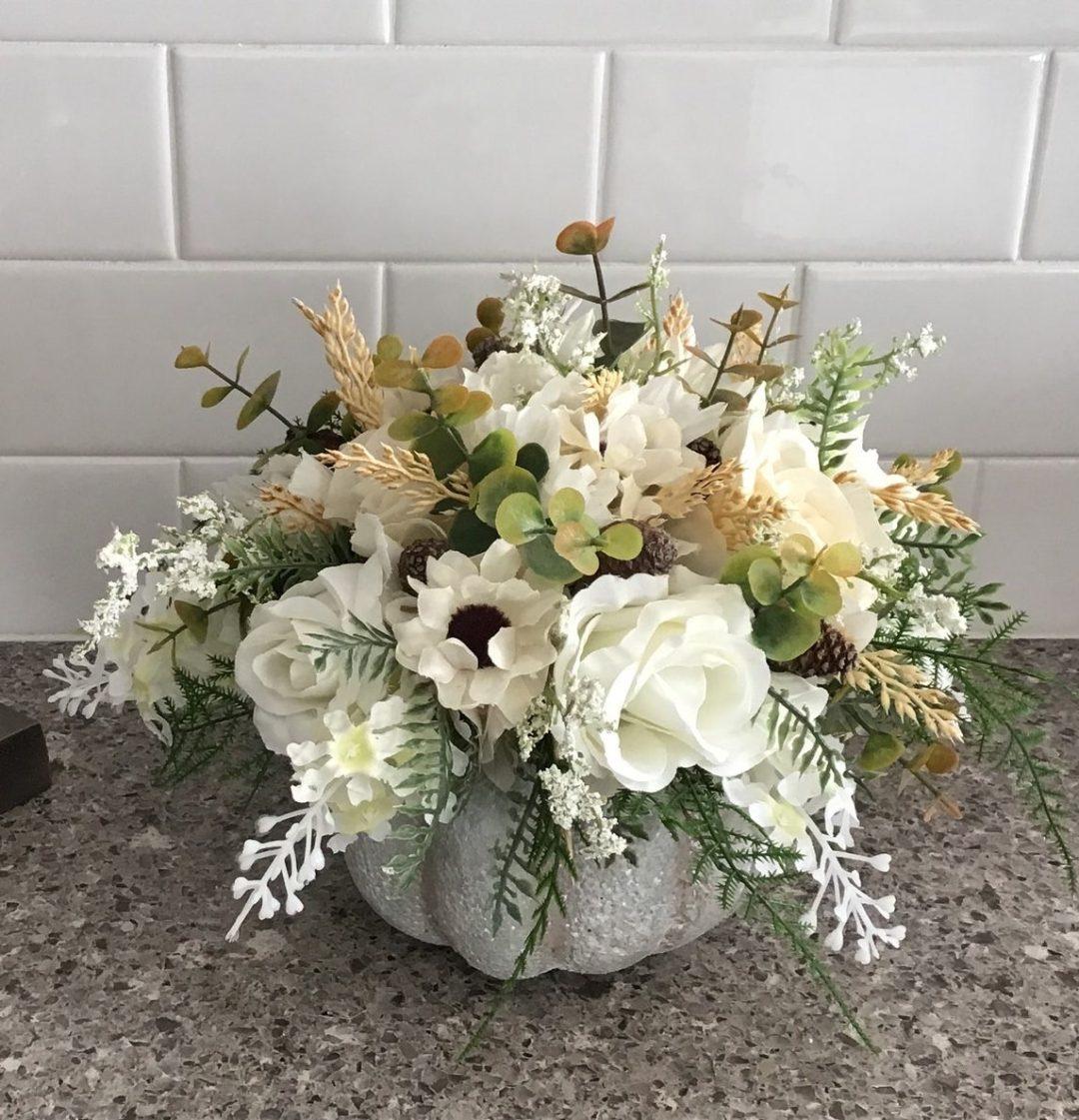 White pumpkin flower arrangement centerpiece