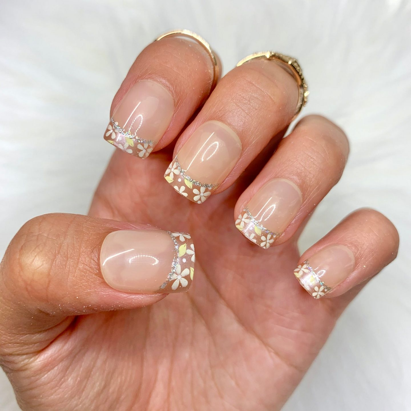 Short coffin shaped daisy French tip nails