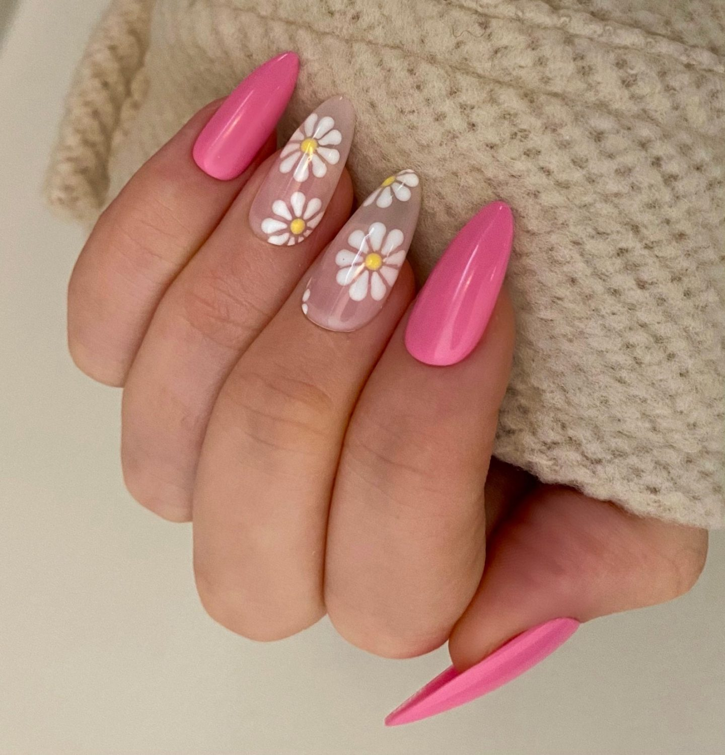 Pretty hot pink almond nails with daisy nail art
