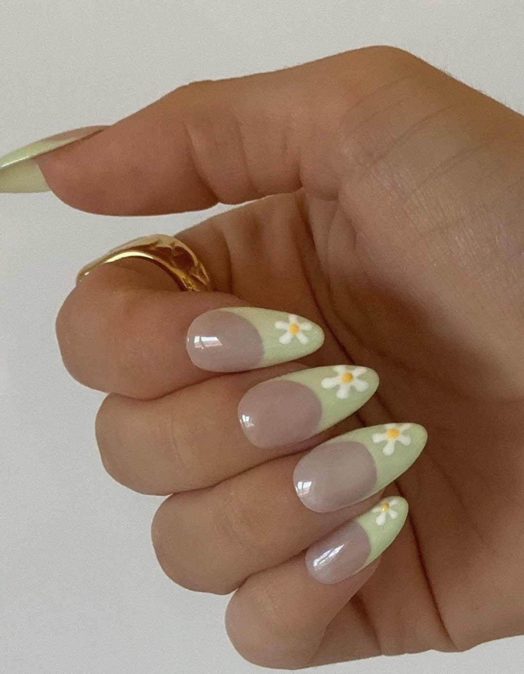 Cute sage green French tip nails with daisy nail art