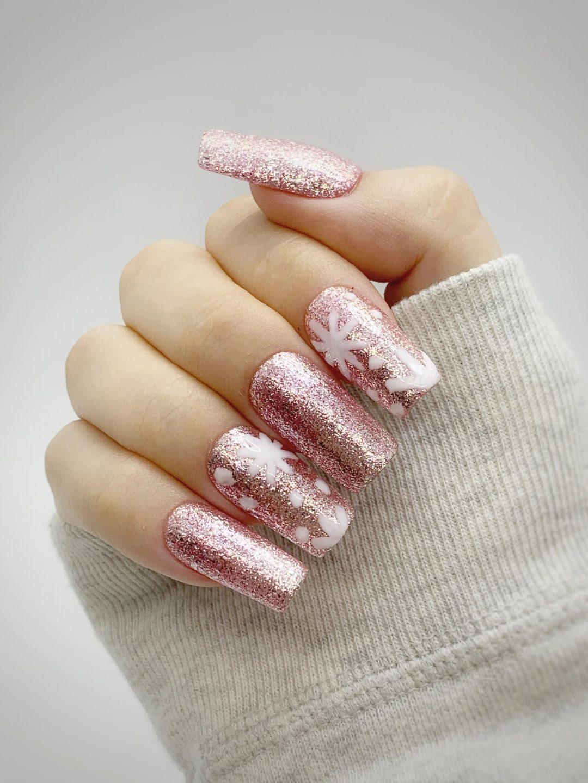 Pink glitter snowflake nails