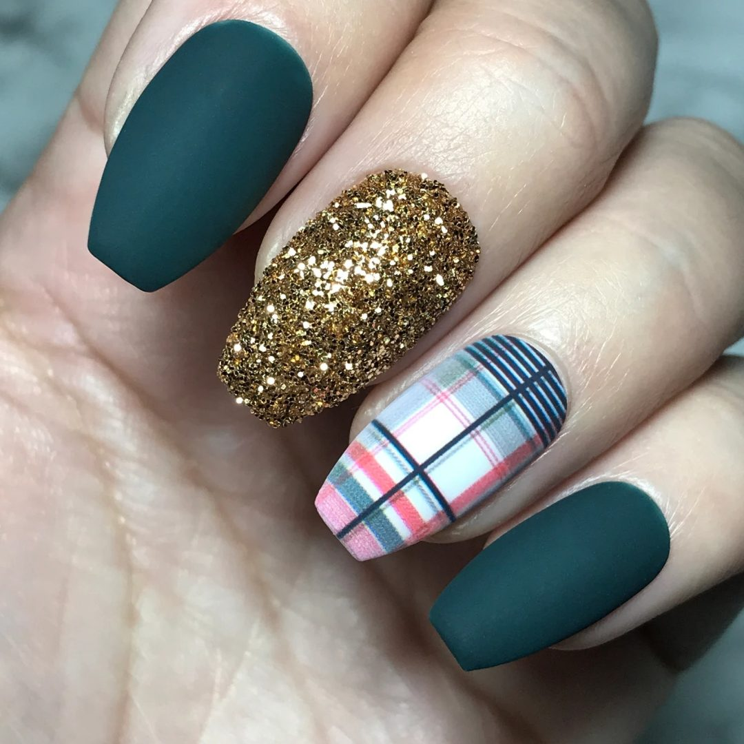 Matte emerald green nails with gold glitter and multicolor plaid nails