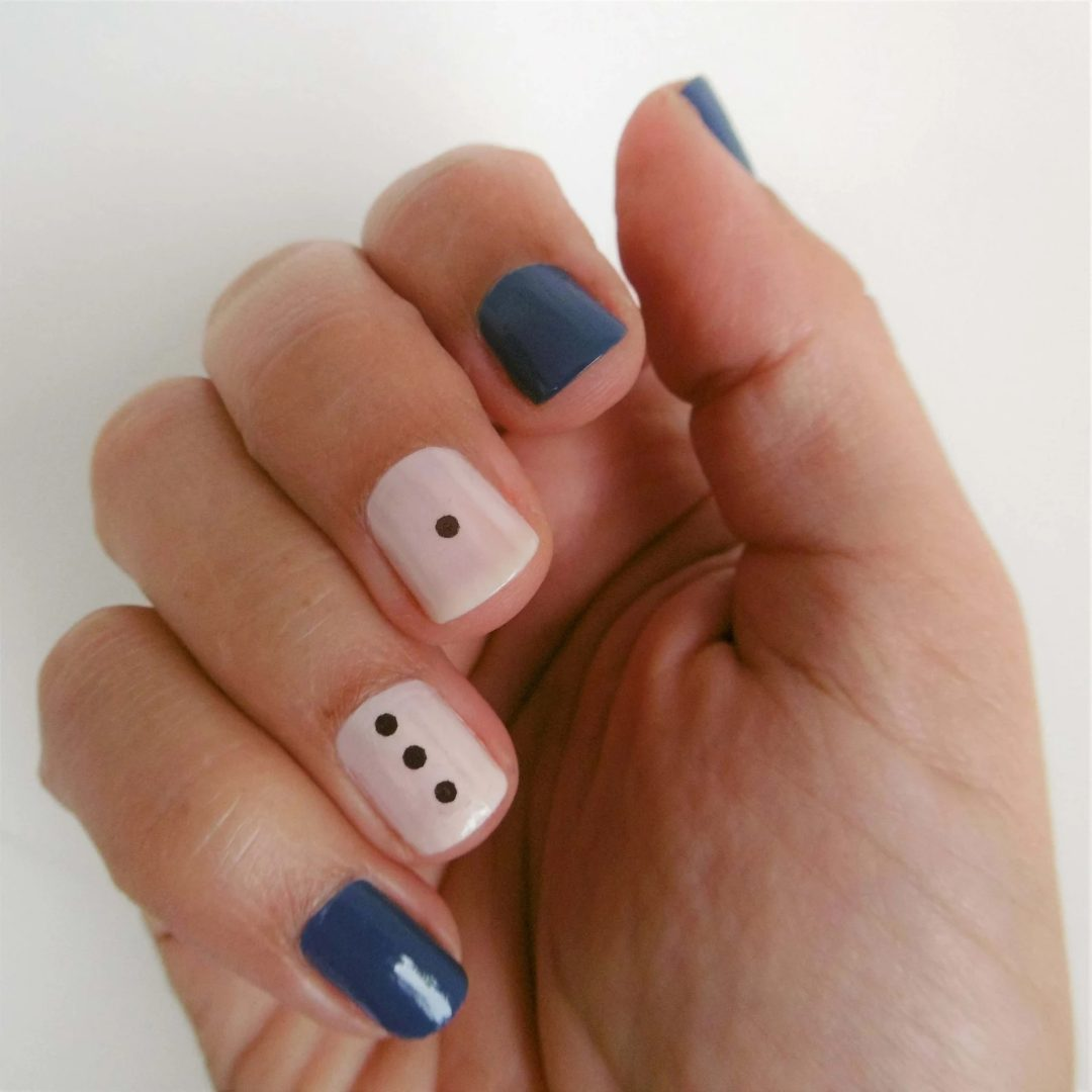 Blue and white nails with black dots