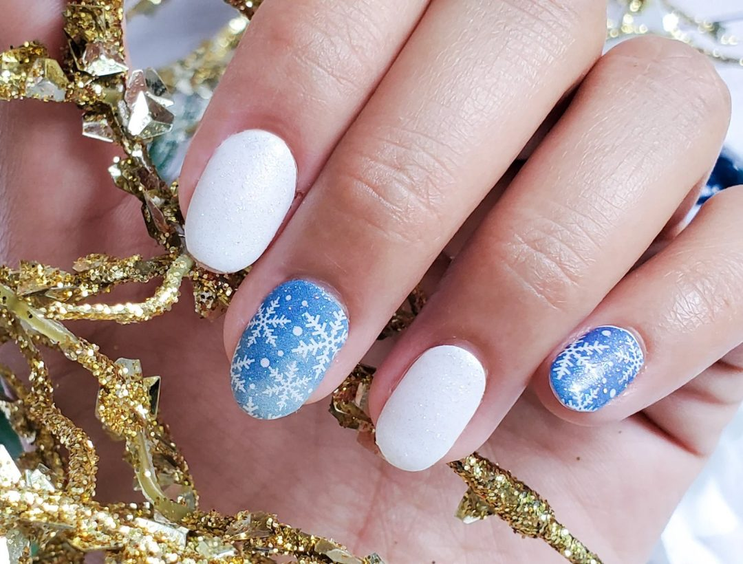 Blue and white snowflake nails