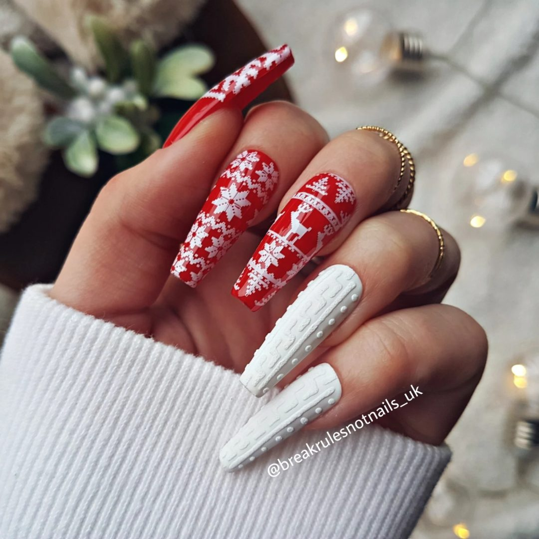 White and red sweater and snowflake nails