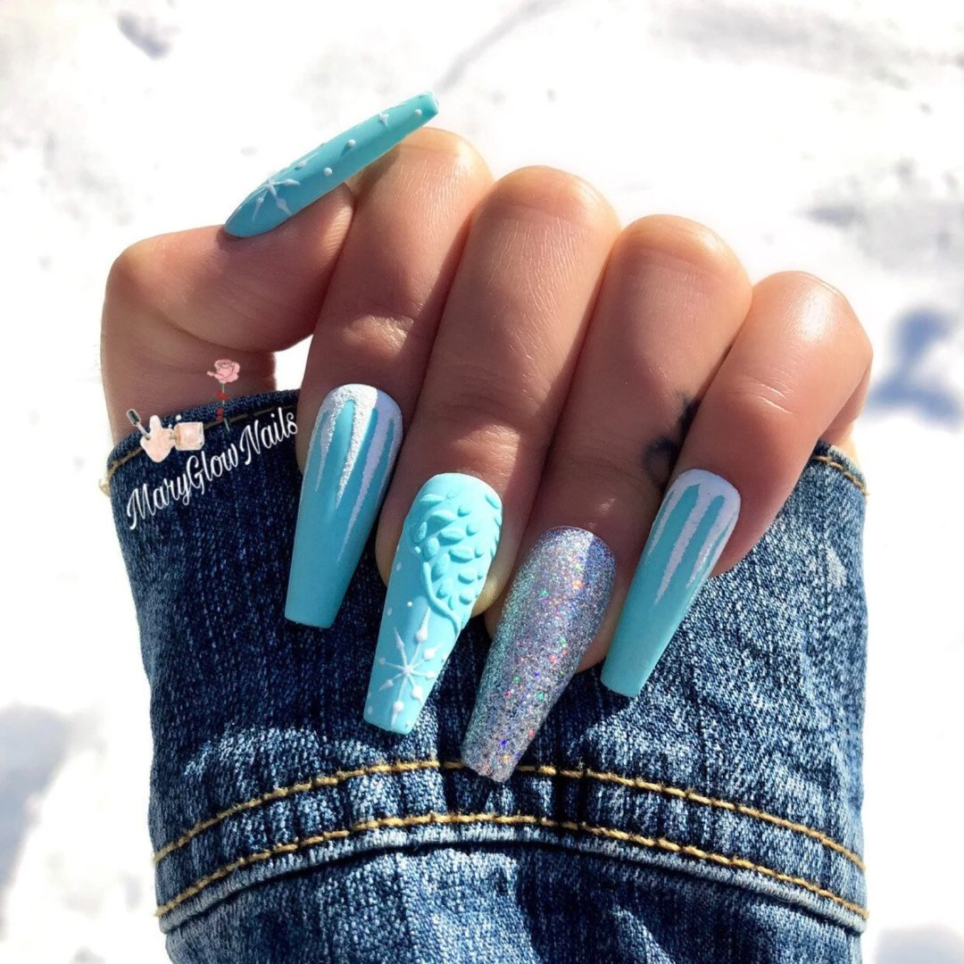 Baby blue snowflake nails with glitter