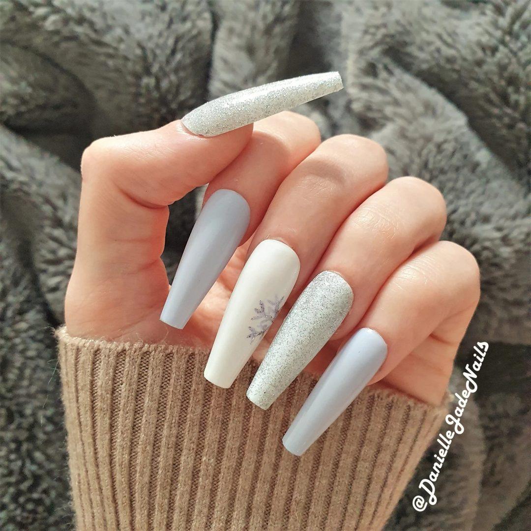 White and grey snowflake nails