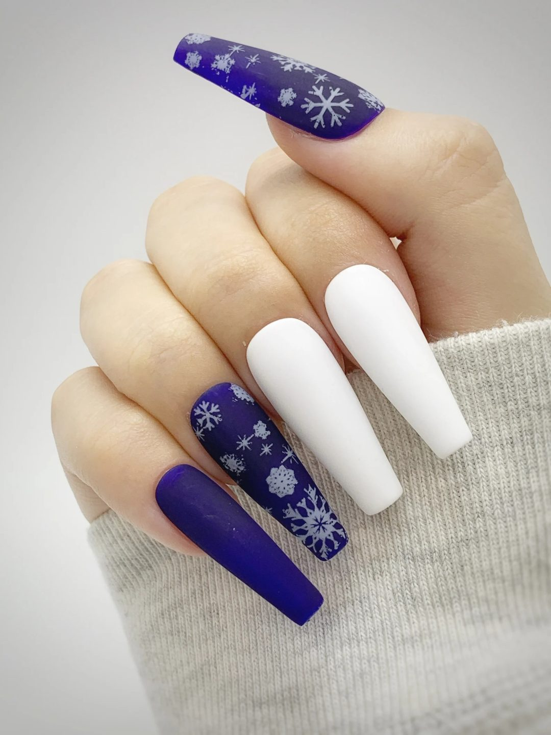 White and blue snowflake nails