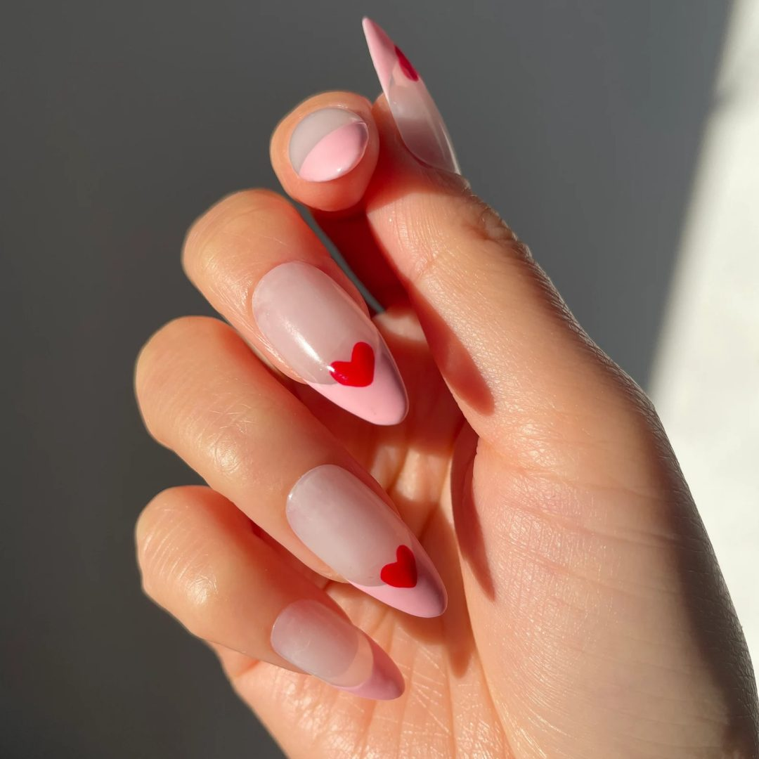 Pink french tips with hearts for minimalist nails