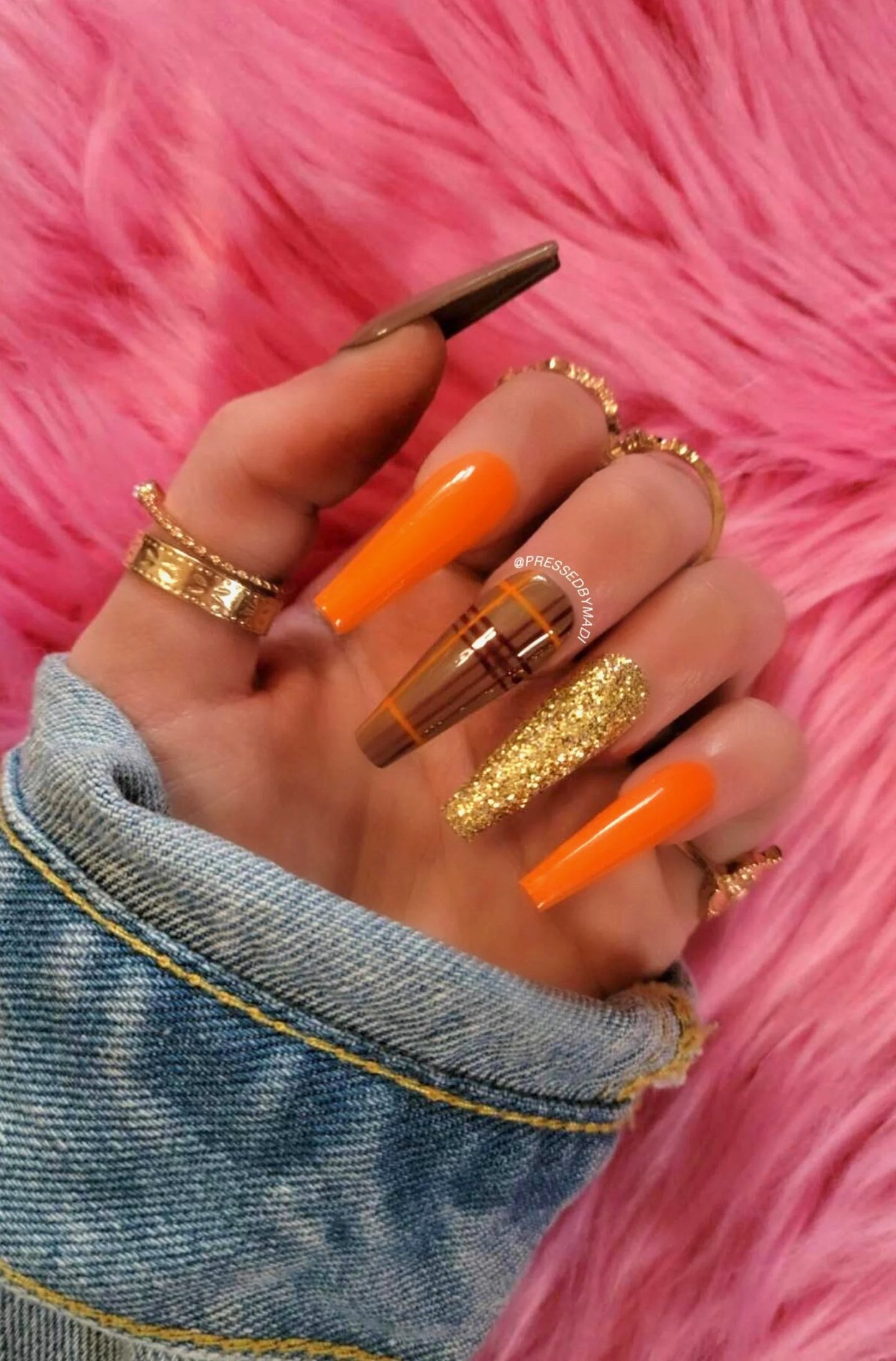 Orange and brown plaid nails with gold glitter