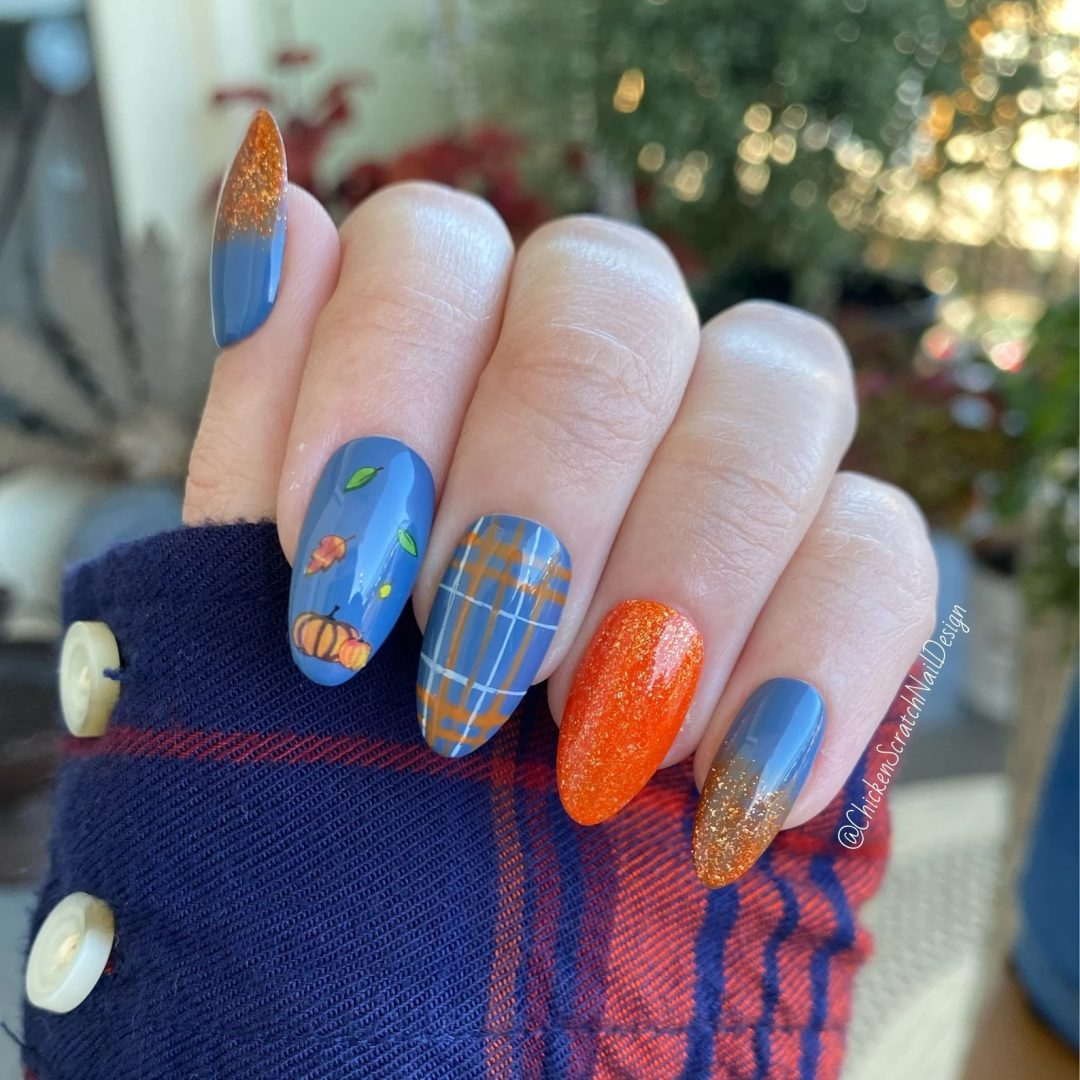 Blue and orange fall plaid nails with glitter