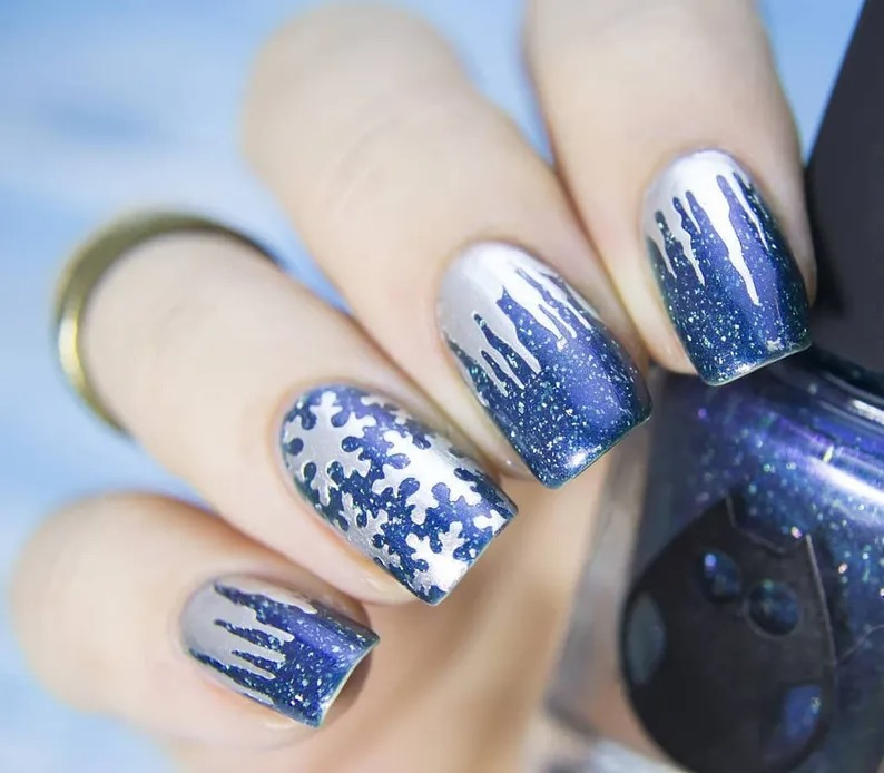 Blue and silver snowflake nails