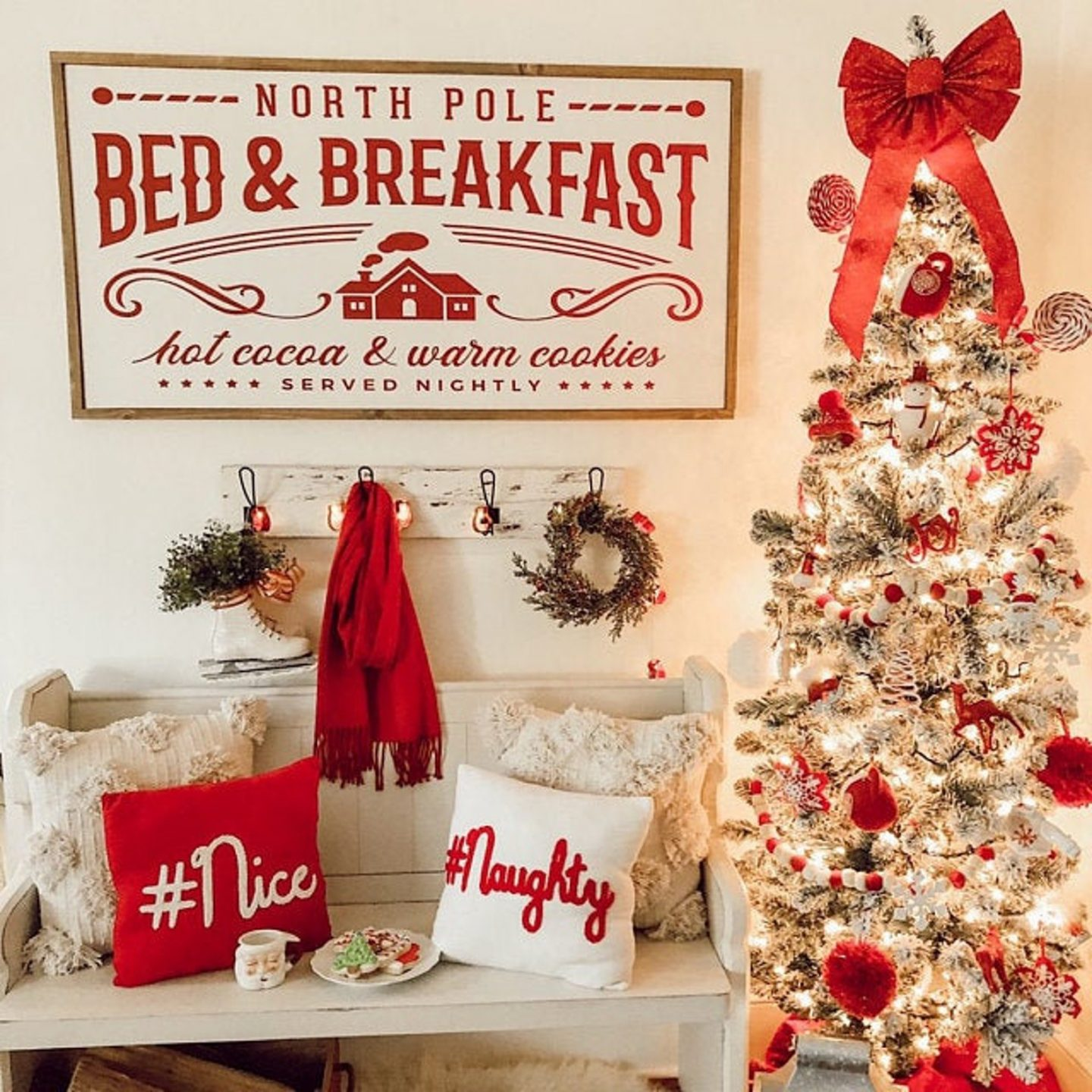 White and red Christmas decor with elegant tree and farmhouse sign