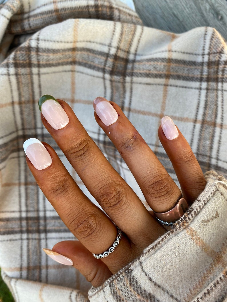 Minimalist and simple French tip nails with brown and green