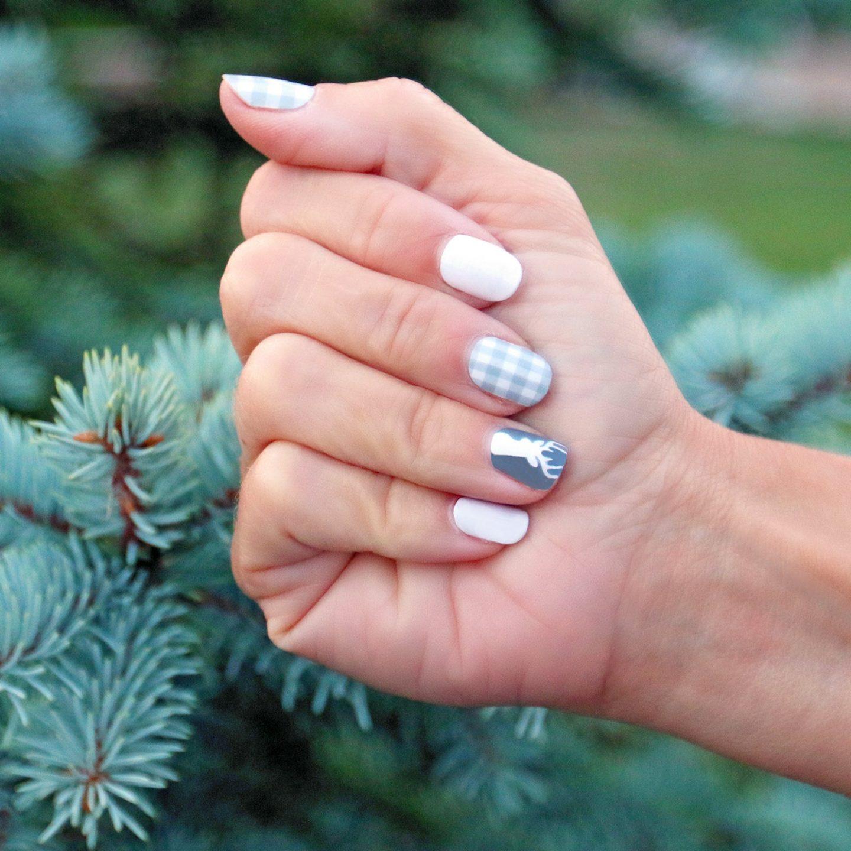 Cute short light grey buffalo plaid nails with deer nail art