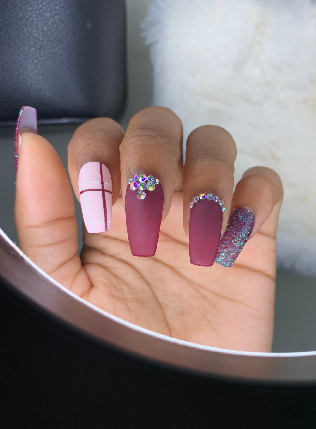 Cute matte plum plaid nails with glitter and rhinestones