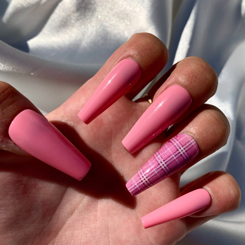 Long hot pink tartan nails in coffin shape