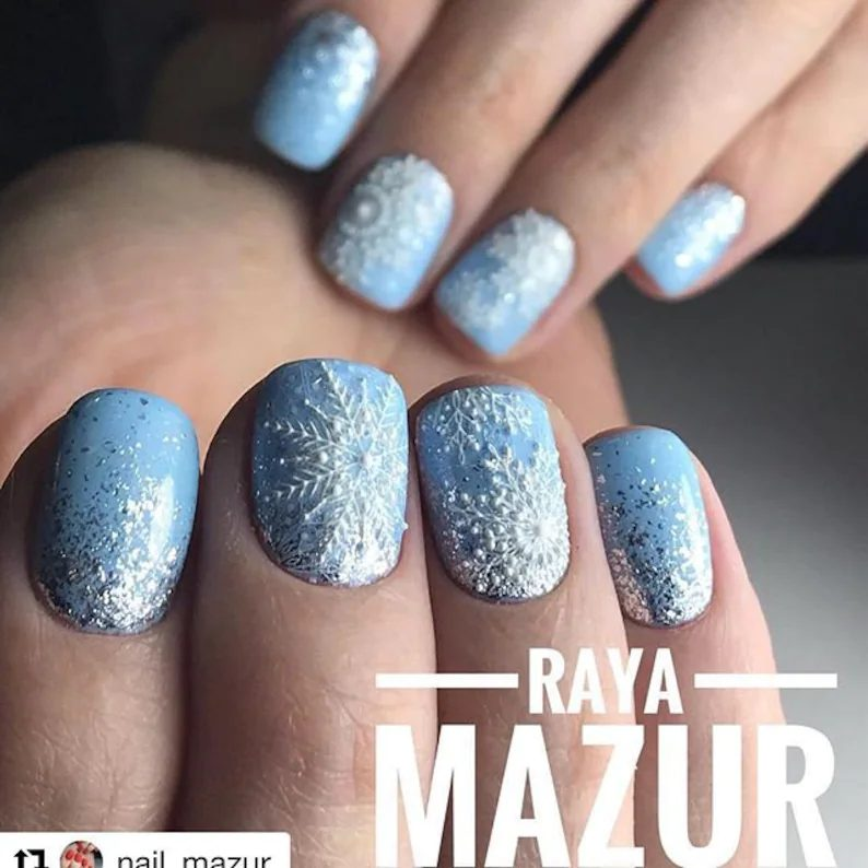 Light blue snowflake nails