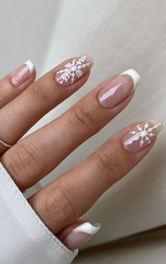 Cute minimalist white snowflake nails with French tips